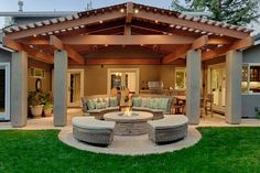 Modern backyard covered patio ideas with fire-pit