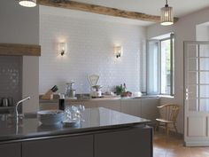 Steel Italian kitchen at Hautfrage House, Studio Maclean's remodeled farmhouse in South West France available for rent