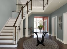 Entryway color.  Benjamin Moore Paint Colors - Blue Entryway Ideas - Beguiling Blue Entry - Paint Color Schemes . . . . . Two blues give this entry a double dose of charm. . . . . . Walls (in entryway under stairs) - Cloudy Sky (2122-30); Stairway Walls - Smoke (2122-40); Hallway Wall (walls in hallway beyond entry way) - Coral Bronze (1298).
