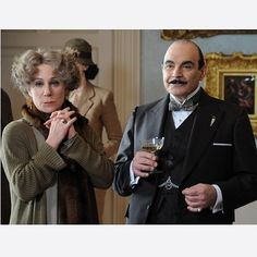"""Ariadne Oliver (Zoe Wanamaker) and Poirot (David Suchet) survey the scene in Third Girl (2008).  ~   Mrs Ariadne Oliver, """"one of the foremost writers of detective and other sensational stories."""" She accompanied Poirot on several of his most famous cases, offering solutions based on her astute female intuition. But she was more than just a bit of light relief for her alter ego Agatha Christie, who was also partial to eating apples in the bath."""
