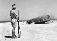 Stuka Burning in North Africa Australian soldier observing the burning wreck of Ju 87B Stuka dive bomber, near Tobruk, Libya, 1941.  photo courtesy of Australian War Memorial