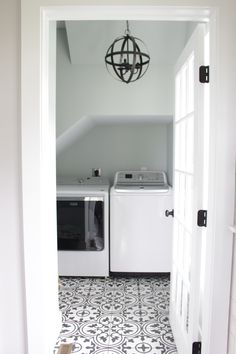 This 1900s outdated family house was transformed into a modern farmhouse with all the bells and whistles including black hardware and black lighting, pattern floor tile, and open concept. Country Interior Design, Farmhouse Interior, Modern Farmhouse, Farmhouse Style, Laundry Room Tile, Farmhouse Flooring, Starter Home, Floor Patterns, Stacked Washer Dryer