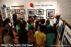 School children from Harford Primary, on St Helena Island, being given a guided tour of What The Saints Did Next's photography exhibition in May 2016, called, 'Labour Take-On Time.'  The project presented our centuries old culture of discharging cargo from ships anchored in James Bay using small lighters.  This way of life will change dramatically once the airport becomes fully operational and the RMS St Helena is no longer required. Exhibition being held at the Museum of St Helena.
