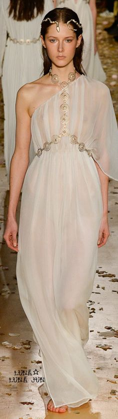 This is a design by Valentino in his Spring 2016 Couture, and it was influenced by Greek dress.  The draping of the dress and accessories show the assimilation to Greek clothing.