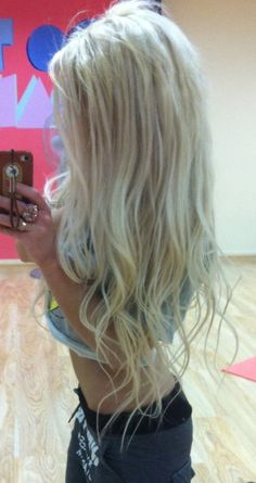 Long blonde waves.  I can't see her face or body,but I just KNOW that she is HOT!!!