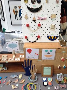 Lucie Ellen at Renegade Fair - I love the scalloped and randomly holed pegboard and those paperboard hands... why haven't I thought of that? :-D