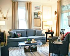 Little Green Notebook: Room Tour: Anne's Living and Dining Room-- I love the contrasting piping on this sofa.