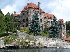 Singer Castle: Designed after Scotland's Woodstock Castle by renowned architect Ernest Flagg at the turn of the century, this landmark is complete with dungeons, turrets, secret passageways and winding stone stairways. It is 300 ft north of the St. Lawrence Seaway in the Thousand Islands