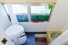 """Outside Found """"Skoolie"""" school bus conversion – bathroom with Nature's Head composting toilet and galvanized bucket shower School Bus House, Old School Bus, Converted School Bus, Diy School, Bus Motorhome, Rv Bus, Bus Living, Tiny Living, School Bus Conversion"""