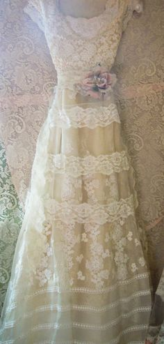 Lace Wedding Dress handmade by vintage opulence on Etsy The top is a soft cream/nude colored lace with lining,and a vintage lace sash The skirt is an asymmetric style, vintage lace with a cream colored vintage floral embroidered mesh over the top, lined   Finished with a pink rose (optional)   Size Bust 34-36 inches waist 28-29 inches 52 inches at the front 62 at the back  Please ask me about adjustments to your size or a custom order. A similar dress can be found here;  https:/&#x2...