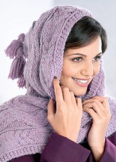 Pat Menchini's cosy cabled hooded scarf complete with tassels will certainly keep you toasty this winter. It's two accessories in one!
