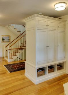 In place of actual walls I want to use something like this built in room divider to create an entryway by the new front door - could use it as a coat closet and shoe cubby