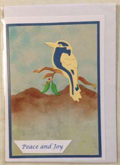 Inked landscape using ink daubers. Die cut bird with contrast die cut inserts