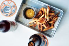 Brining these fries in a salt-and-cabbage solution seasons them and, as they start to lightly ferment, infuses them with a slight tang. Think salt-and-vinegar chips and you get the right idea.