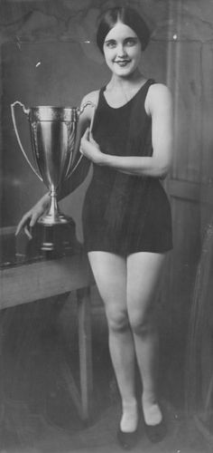 "Delores Conrad,  ""Miss Denver, 1926,"" in the Atlantic City bathing beauty contest, holding the silver loving cup that will be one of the first prizes in the Denver Post's Rocky Mountain region Bathing Beauty Review"