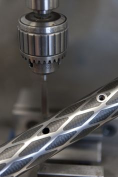 This is beautiful machining. Exogrid bicycles, of Holland, laser-cuts material from the surface of titanium tubing to reduce weight, but leaves a diamond pattern for structural strength.
