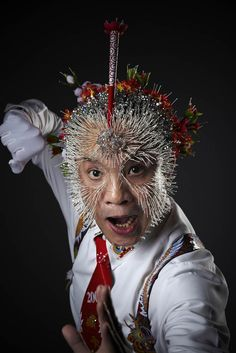 """The most needles on the head is 2,009 and was achieved by Wei Shengchu of China on the set of """"Lo Show dei Record,"""" in Milan, Italy, on April 11th, 2009."""