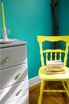 Yellow chair in an emerald green room, interior by morgan pederson