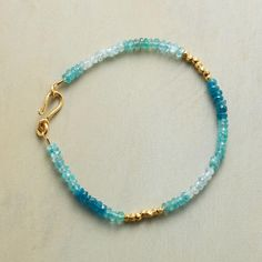 "ULTRAMARINE BRACELET -- An apatite, aquamarine and gold vermeil bracelet, with beads of 22kt vermeil shimmering like sunbeams among apatite and aquamarine rondelles. Hook clasp. Handmade in USA. 7-1/2""L."