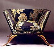 What a fabulous chair - from the shape to the fabric