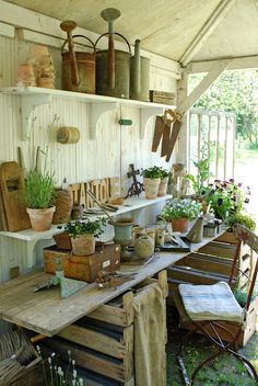 pretty rustic stacked crates with boards over top for a makeshift (though wonderful) potting table inside garden shed