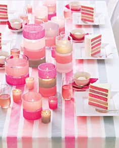 Some good tips: Combining color and a design element such -- such as these stripes of streamers -- gives decorations a powerful punch. Cover the table with white poster paper, and unroll streamers along its length, affixing them at intervals with double-sided tape. Top with glassine. For candleholders, use double-sided tape to attach streamers around glass holders.