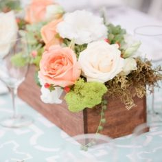 A lovely wedding full of unique details. The bride's dad is a woodworker, and he made all the wooden boxes they used for their centerpieces!
