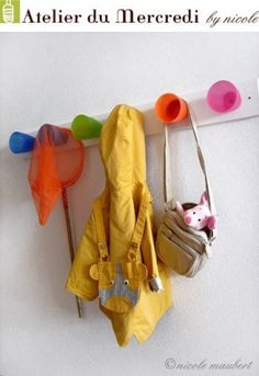 Use kids cups for coat hooks!