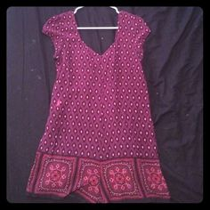 "Boho Free People Romper Perfect for festivals!! Super comfy and cute. Maroon boho print cotton rompe from Free People. Loose fitting ""shift dress"" style. Corset tie back detail. Small stain shown in last picture but hardly noticible. Free People Dresses Mini"