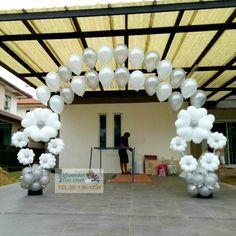 Silver and white balloon blossoms and string of pearls helium twin arches...perfection!