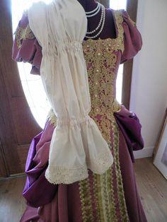 Can be worn with huge billowy bishops sleeved undersleeves.