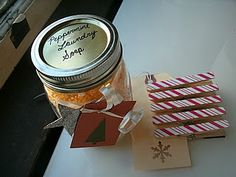 Homemade peppermint (or any other scent) laundry soap is a great Christmas gift. Recipe included. Cute decorated clothespins.