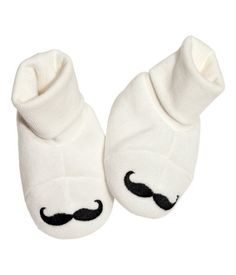 Teeny mustache bootees