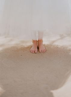 dress and feet in the sand