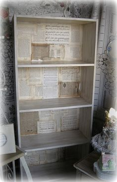 great shelving idea...for the two plain white bookcases.