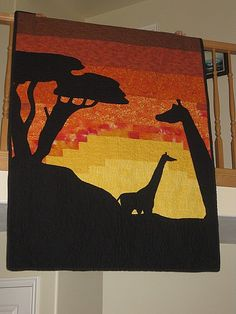 This is very similar to my senior quilt my mom made....except mine had elephants on it :)