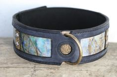 State-of-the-art NUN collar is especially handcrafted for large breed dogs with red, golden, beige, white or pale brindle coat. The underlying leather is wonderfully hand printed with pale blue and golden nuances and has miniature antique rivets. The overlying leather is bluish grey in color with the matching antique embossing.