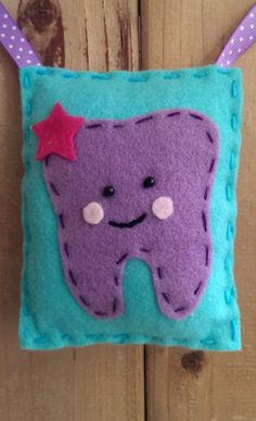 Hey, I found this really awesome Etsy listing at https://www.etsy.com/listing/189521850/handmade-felt-tooth-fairy-pillow
