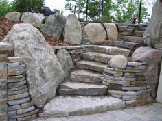 Landscaping On A Hill, Landscaping With Rocks, Modern Landscaping, Stone Masonry, Concrete Stone, Garden Steps, Garden Paths, Boulder Retaining Wall, Faux Stone Walls
