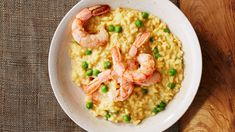 Plump shrimp and fresh spring peas make a delicious duo in this lemony risotto, while a pinch of saffron gives it a striking golden hue.
