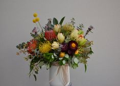 A mix of seasonal (October) natives - banksias, leucadendrons, pinchusions, strawflowers, billy buttons & pixie mop. This will last for weeks & dry beautifully.