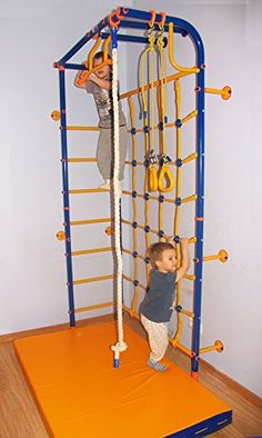 Wall-Corner - Kid's Home Gym Swedish Wall. Swedish wall is designed to perform a variety of sport activities, contributing to a more complete physical development of children from 3.5 years. The complex can be used in the home with a ceiling height of 2.40 m Equipment: - wall bars - horizontal bar with a wide grip - climbing rope - gymnastic rings - climbing net. Type of mounting - to the wall. The diameter of the pipe - 42 mm Rated operating load on the metal part of the complex - 100 kg...