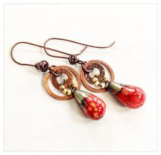 Handmade earrings Beautiful bright red ceramic drops by Petra Carpreau on Copper hoops which have been bashed, oxidized and waxed, with pretty yellow Picasso seed beads. About from bottom of handmade copper earwires by Lucy Haslam. Handmade Copper, Persephone, Clay Beads, Petra, Jewelry Crafts, Earrings Handmade, Seed Beads, Wax, Jewelry Making
