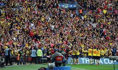 The Arsenal fans celebrate Theo Walcott's goal during the FA Cup Final between Aston Villa and Arsenal at Wembley Stadium on May 30, 2015.