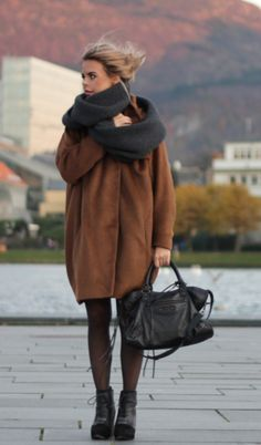 balance a chunky coat with thick heels, textured tights, a durable bag, and a warm oversized scarf