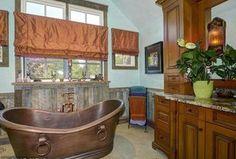 Craftsman Full Bathroom with Flush, limestone tile floors, Handheld Shower Head, Wall sconce, Undermount Sink, Wainscoting