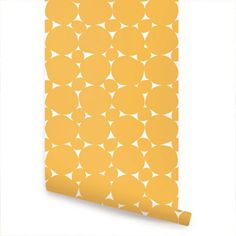 Dot yellow peel & stick fabric wallpaper. This re-positionable wallpaper is designed and made in our studios in New Jersey. The designs are printed onto an adhesive backed fabric that can be remov