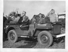 President Franklin D. Roosevelt seated in a Jeep with hat over his heart. General George Patton can be seen saluting the flag on the other side of the Jeep vehicle; George Patton, Jeep Willys, Military Jeep, Military Vehicles, Gi Joe, Saluting The Flag, Jeep Cars, Jeep Truck, Jeep Models