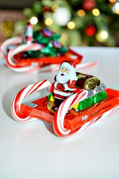 How to Make Candy Sleighs - About A Mom - It is easy to be tempted by sweets during the holidays season. Learn how to make a fun candy sleigh and get tips from the National Candy Association for how to enjoy candy in moderation this holiday season. Christmas Candy Crafts, Candy Cane Crafts, Christmas Gifts For Mom, Homemade Christmas Gifts, Kids Christmas, Holiday Crafts, Holiday Fun, Christmas Decorations, Christmas Sleighs