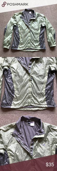 """The North Face Green Gray Windbreaker Jacket L The North Face Green Gray Windbreaker Jacket Size L . cute! Approximate measurements are: chest: 44"""" length: 25.5"""" shell: 100% nylon lining: 100% polyester One black smudge on one of the sleeves (see pic) The North Face Jackets & Coats"""
